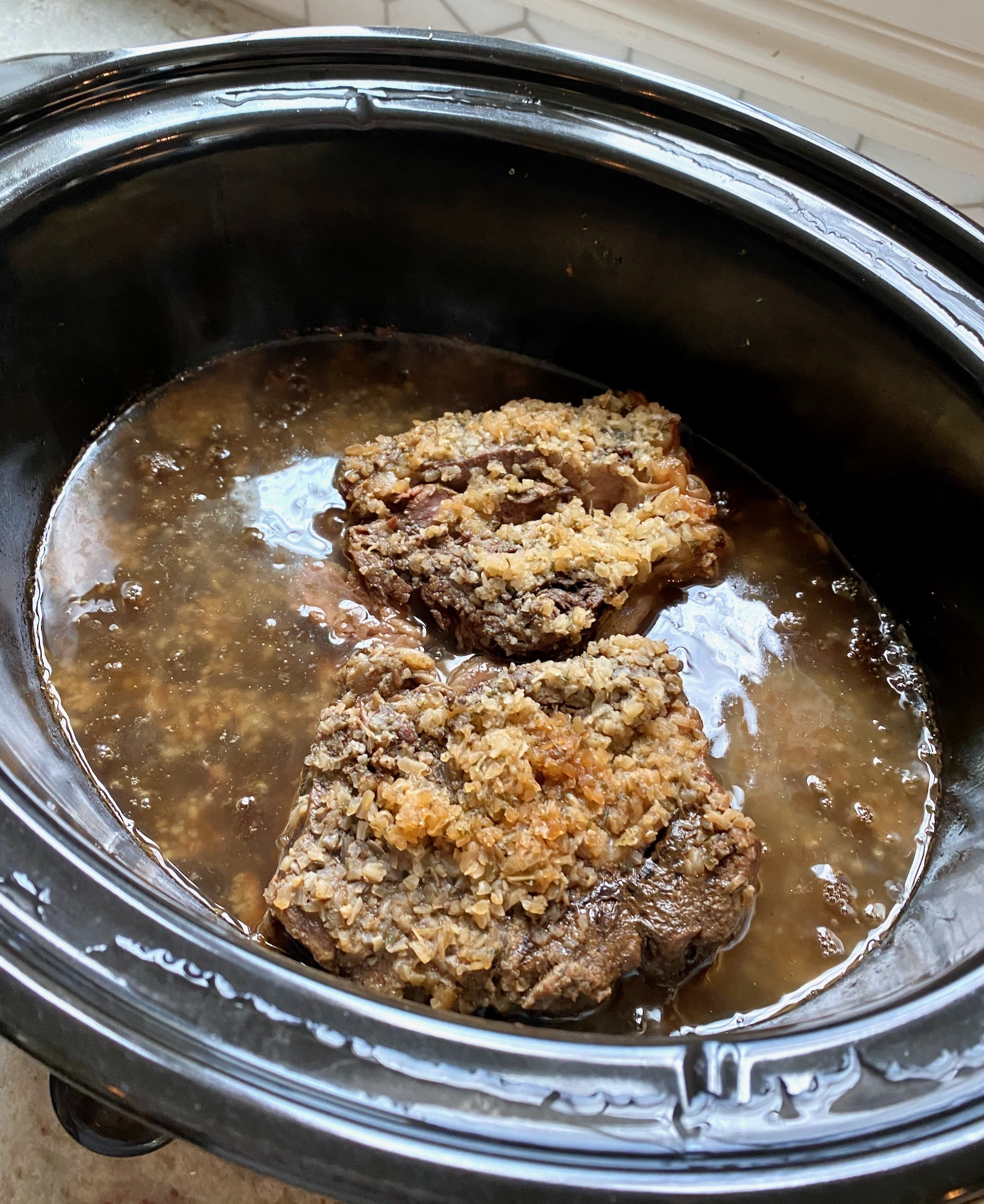 Bake Chuck in a slow cooker with the ingredients for French dipping sauce.