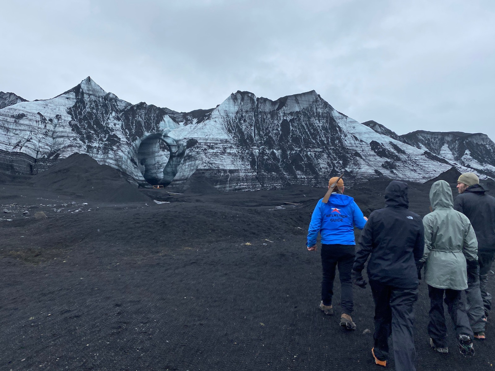 Family and tour guide walking through the lava fields in Iceland.