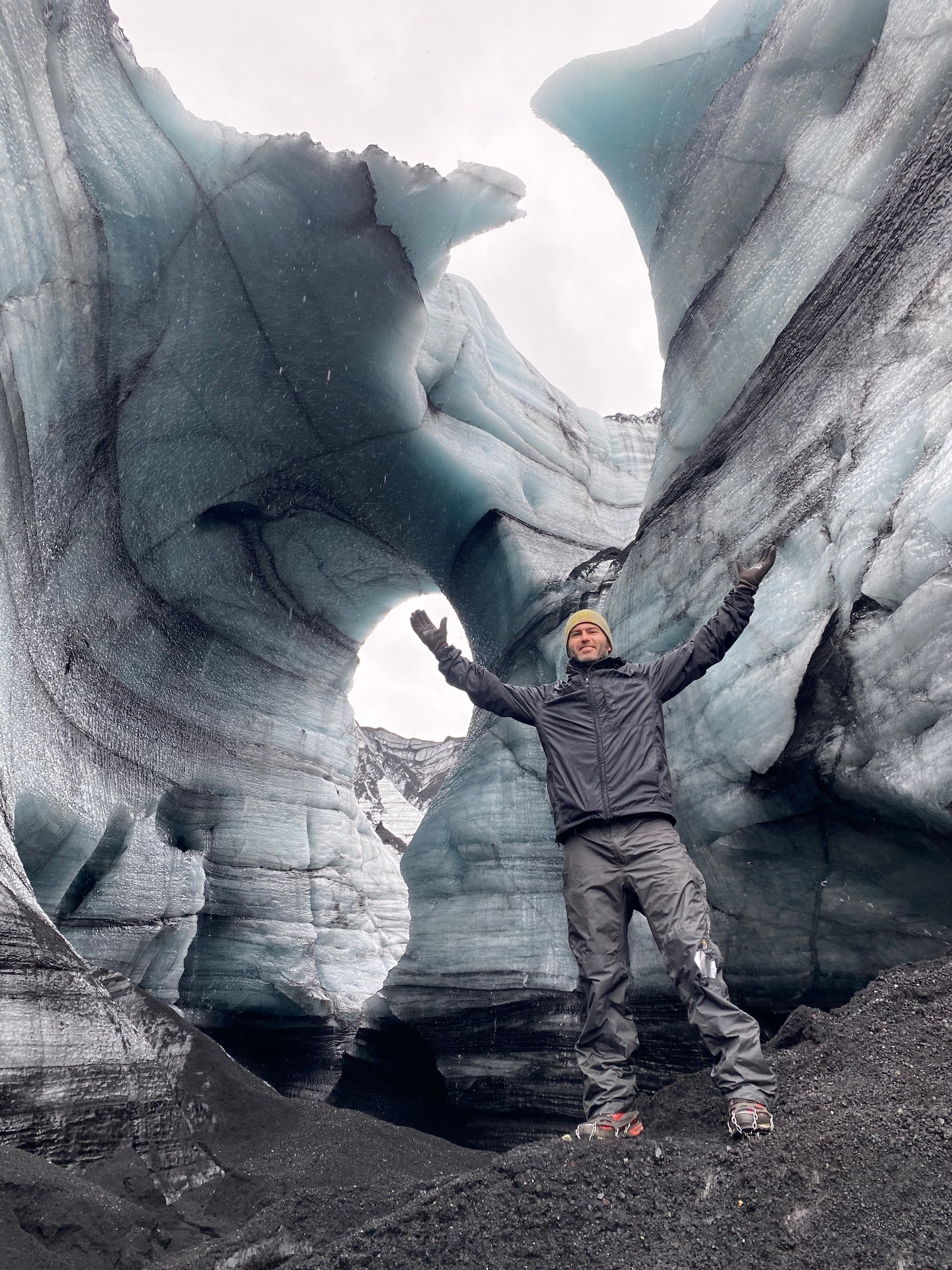 Father posing in ice caves in Iceland.
