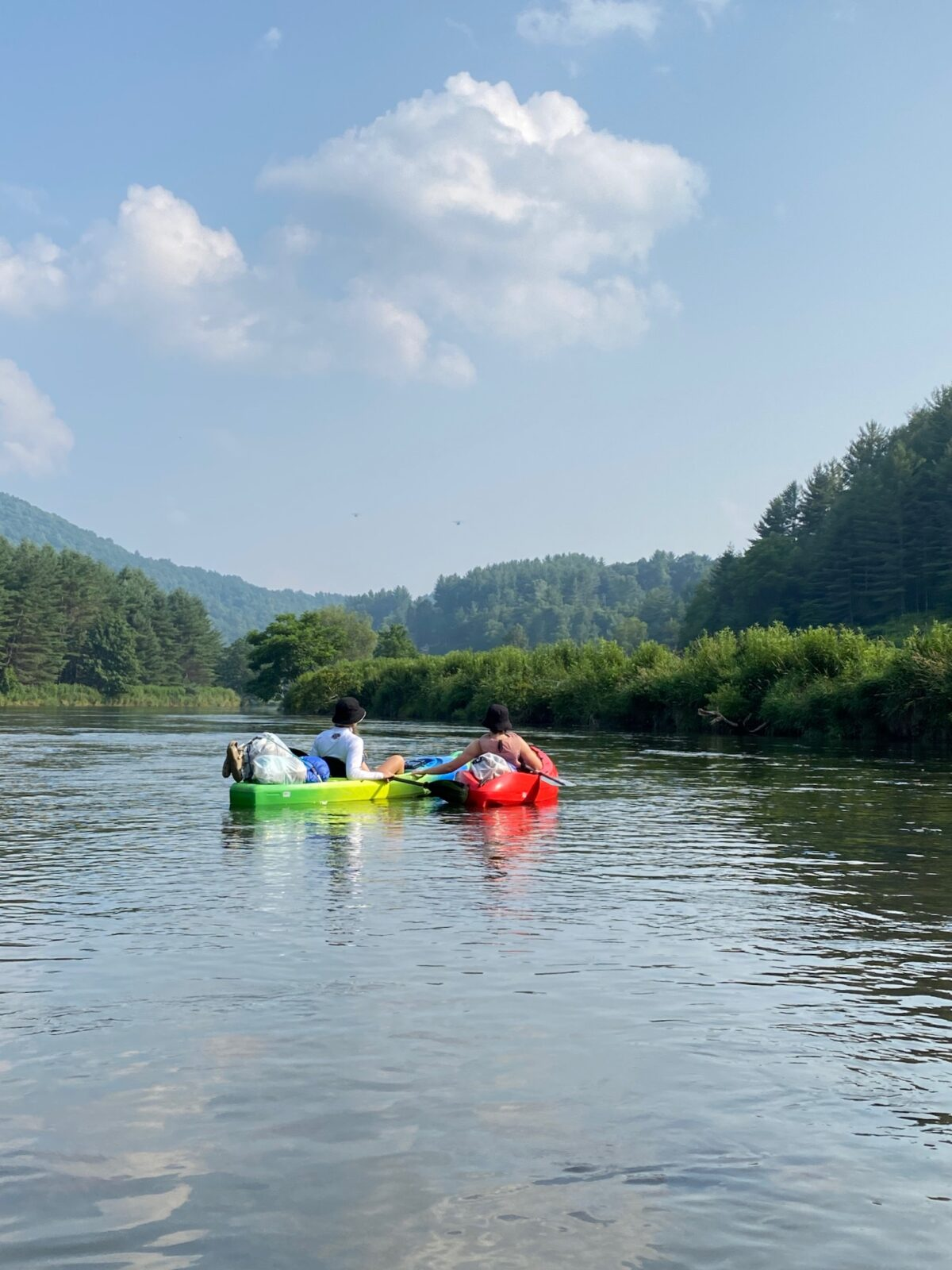 Two people in kayaks on a river in North Carolina.